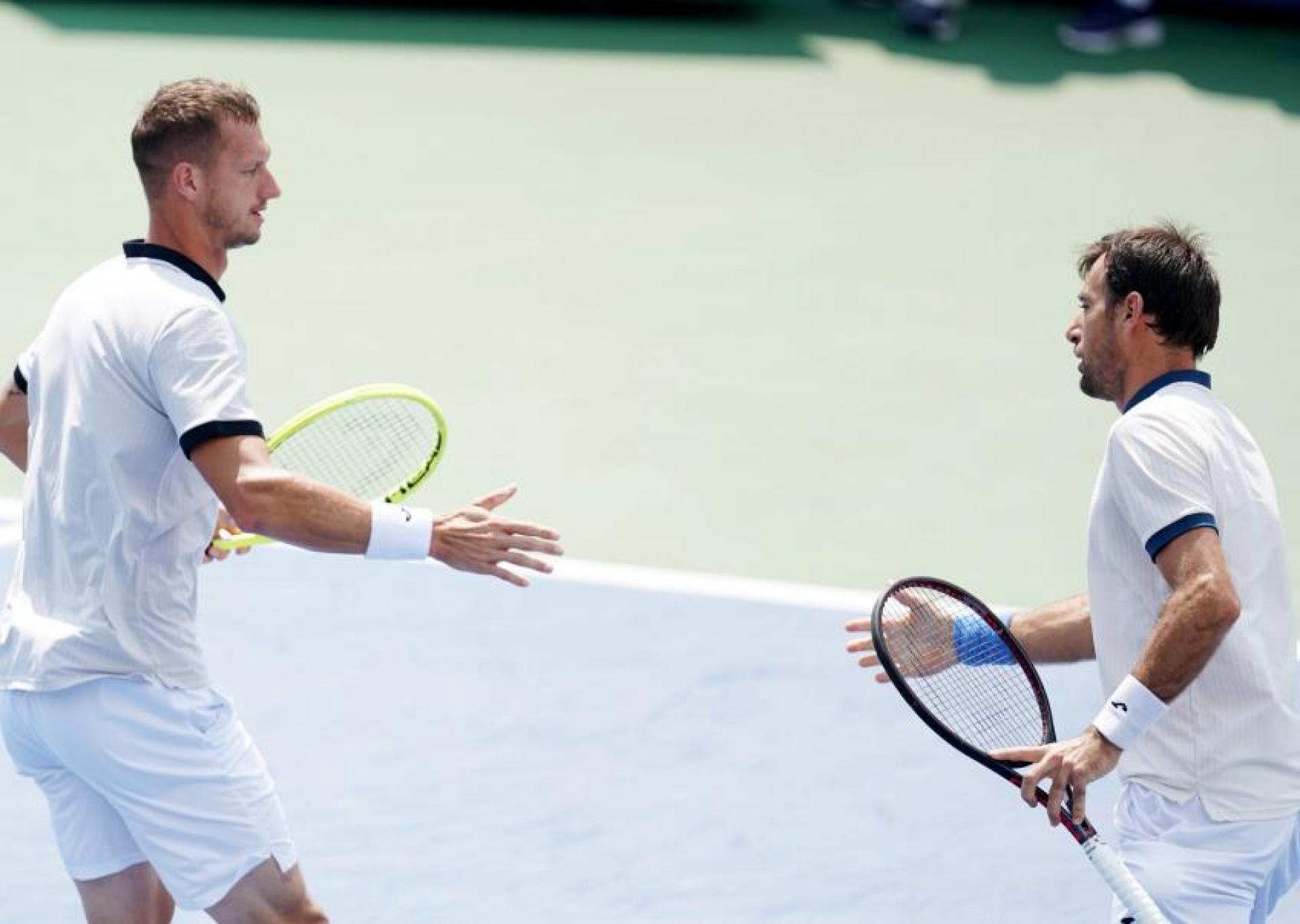 Поласек и Додиг выиграли парный турнир Australian Open